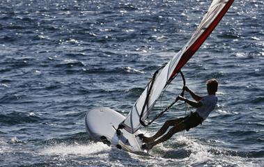 wind surfer heading open sea
