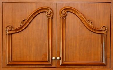Wooden carved wardrobe doors closeup