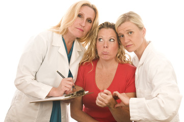 two female doctors nurses in medical scrubs clothes with patient