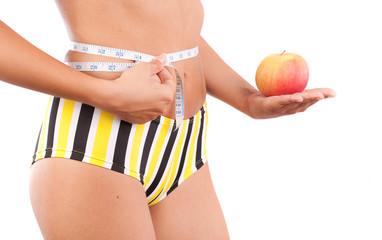 Woman torso and apple. Diet concept