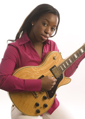 young hispanic black woman playing electric guitar
