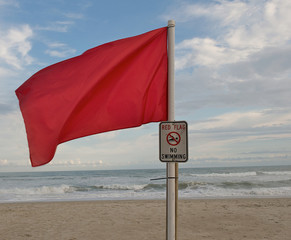 Red flag at the beach during hurricane season to warn of danger.