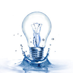 Light bulb with water and splash isolated on white