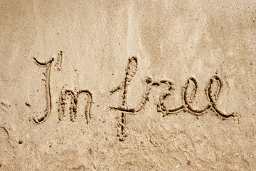 I`m free handwritten in sand for natural, symbol,tourism
