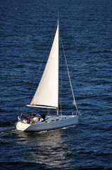lonely boat sailing in a deep blue sea