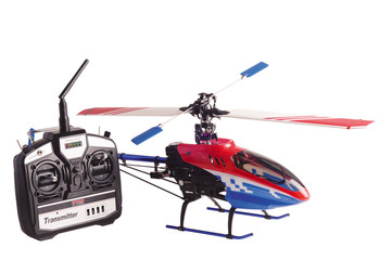Helicopter model and radio remote control set isolated on white