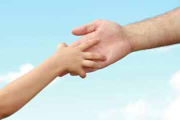 hands of the child and adult