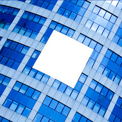 abstract crop of modern skyscraper with white placard