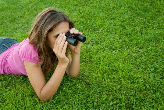 Woman binocular lenses grass
