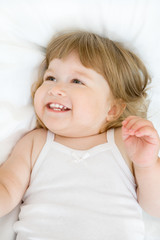 Little girl on a bed