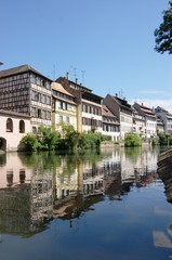 Alsace houses in Strasbourg, reflected in channel