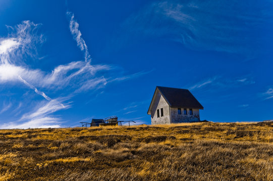 House, grass and sky