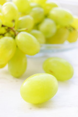 Green ripe grapes in plate