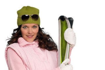 Brown hair woman in winter outfit with skis