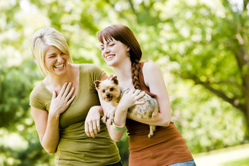 Women with dog walking in a park