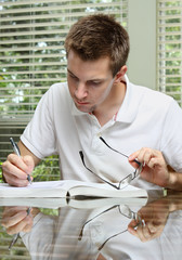 Man working from textbook