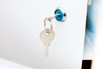 a key in a keyhole in a lockbox door