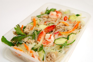 Thai spicy seafood salad in a take away box.