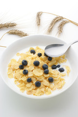 Muesli milk and blueberries in a white bowl
