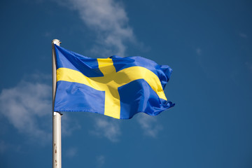 Swedish flag against blue sky