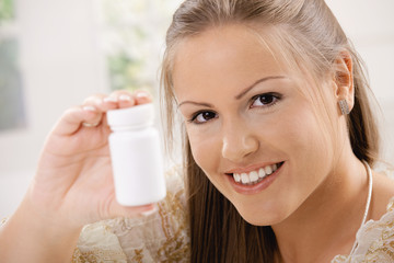 Woman showing pill bottle