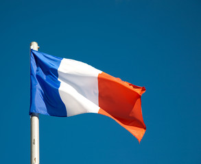 French flag against blue sky