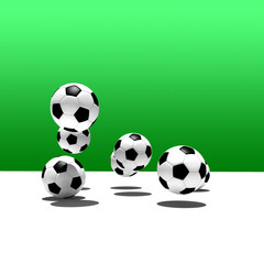 soccer balls on green background