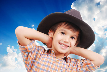 Beautiful little boy with hat on head