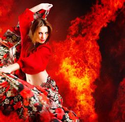 Hot woman dancer. Fire burning in background