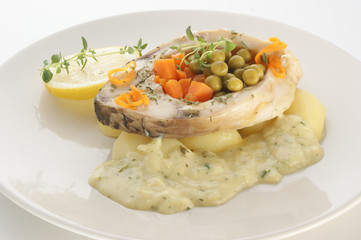 grilled carp fillet on organic potato with vegetable