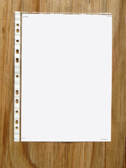 Blank paper in a plastic sleve stapled to a wood board.