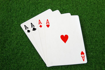 four aces on a green table