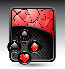 Playing card suits on red cracked background