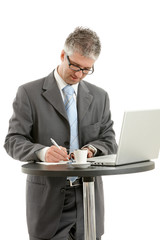 Businessman writing notes