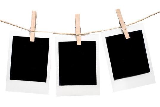 three empty polaroid style film