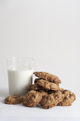 yummy cookies and glass of milk