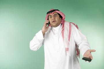 Saudi man using phone