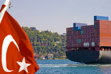 Container cargo ship crossing the Golden Horn along Istambul.