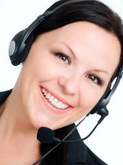 smiling brunette woman talking by headphone