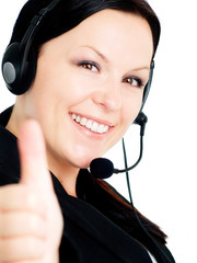 smiling brunette woman with headphone showing ok sign