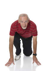 Active senior exercising on white background