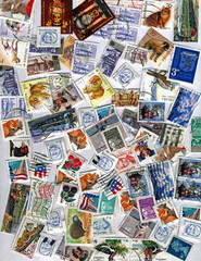 pile of different colorful post stamps, paper texture, frame
