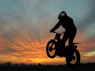 Motorcyclist in sunset