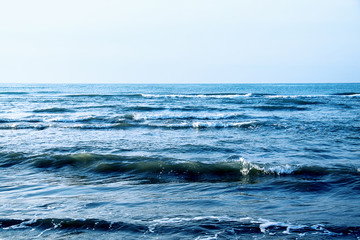 Waves by the dark blue sea