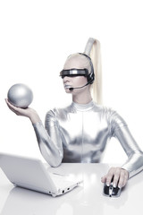 Beautiful cyber woman working on her laptop....