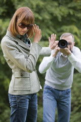 paparazzi shooting woman