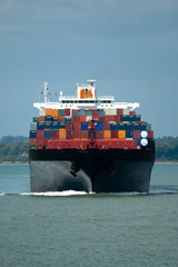 fully loaded container ship head-on