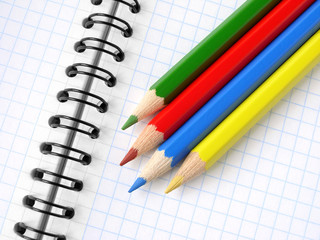color pencils and spiral notepad