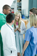 Group of doctors speaking in the hospital