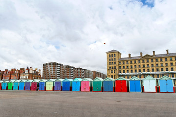 A roll of colourful beach huts along King's Esplanade